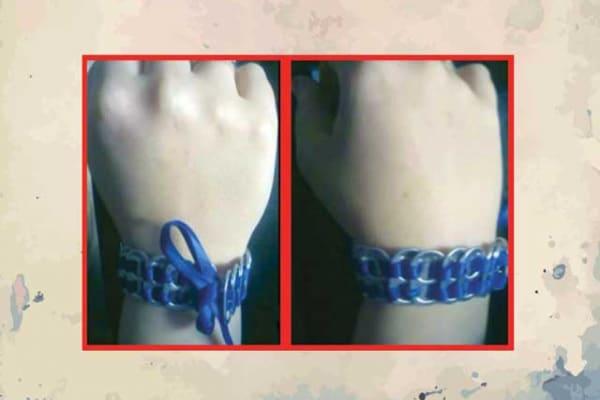 Il bracciale fatto di linguette delle lattine usate